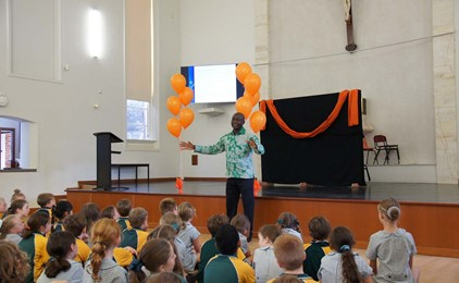 John Sandy shares a message of acceptance with students of Holy Family, Merewether for Harmony Week IMAGE